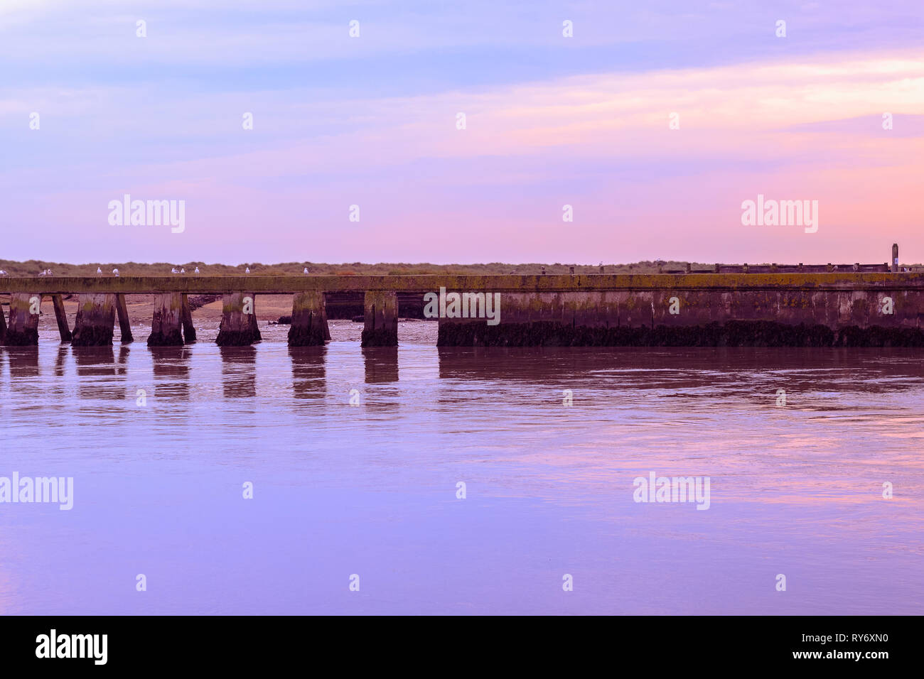 Purple sunset at the junction of River Blyth and Dunwich River in Southwold, a popular seaside town of the UK - Stock Image