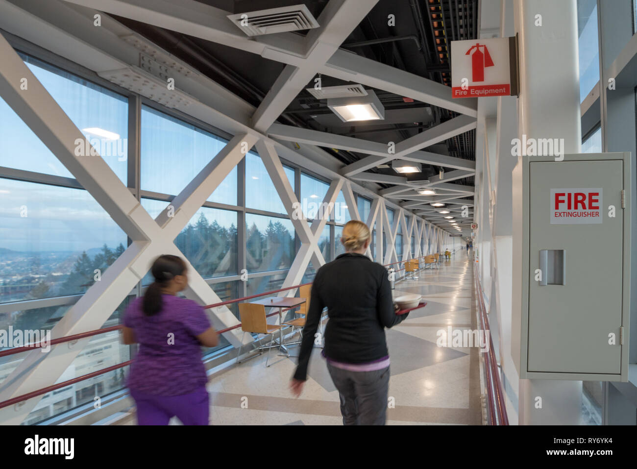 Fire extinguisher in a sky bridge at Oregon Health Sciences University, Portland, Oregon. - Stock Image