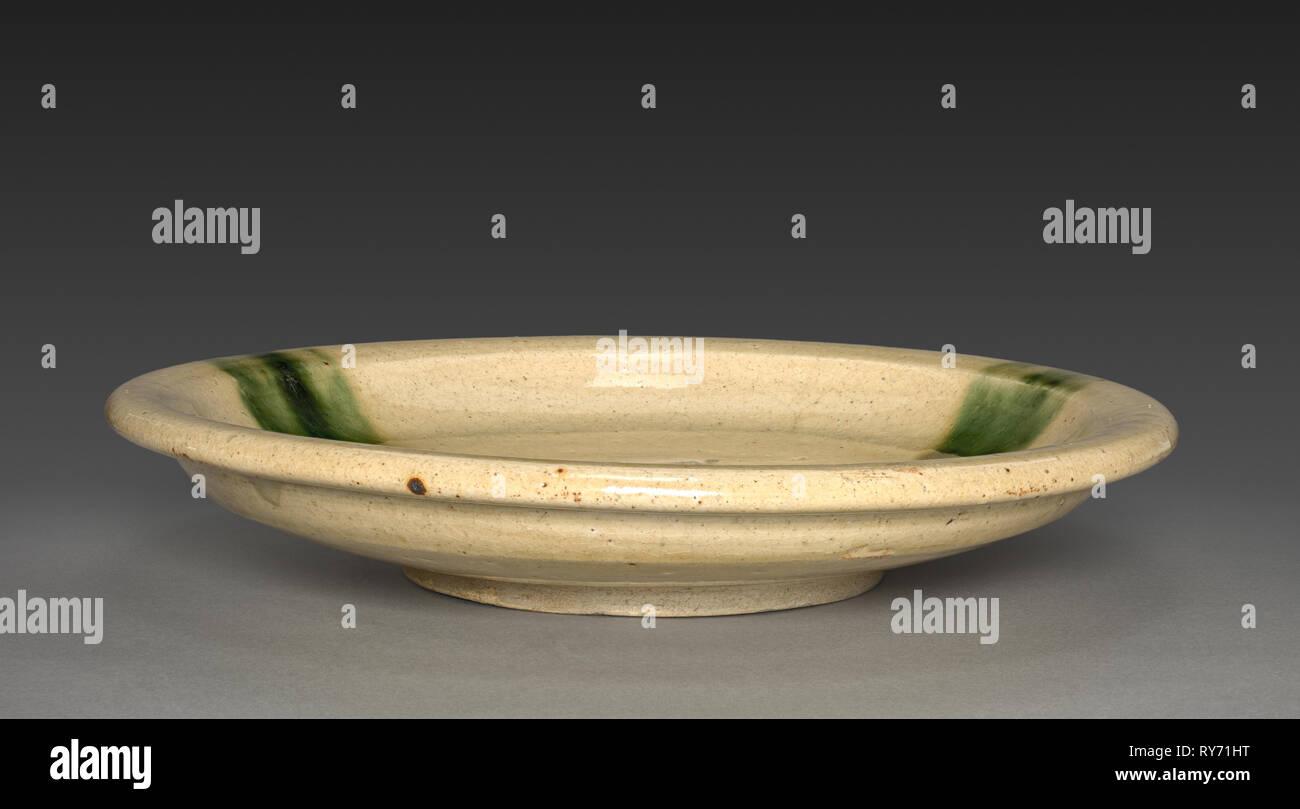 Plate: Seto Ware, 18th-19th century. Japan, Aichi Prefecture, Edo Period (1615-1868). Glazed stoneware ; diameter: 37.7 cm (14 13/16 in.); diameter of foot: 17.2 cm (6 3/4 in - Stock Image