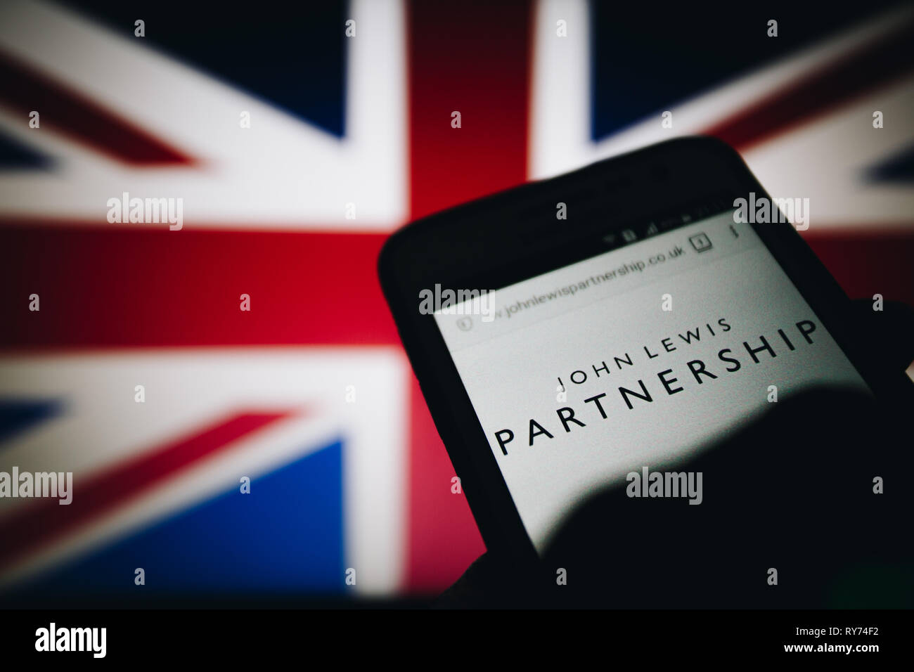 John Lewis Partnership (JLP), an employee owned UK company. Logo on its website is seen on a smartphone display - Stock Image