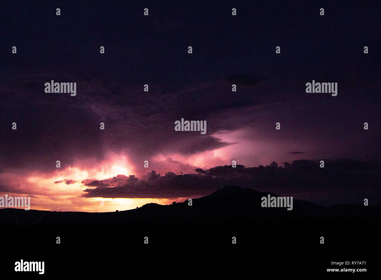 A summer storm rolls in on desert mountains. - Stock Image
