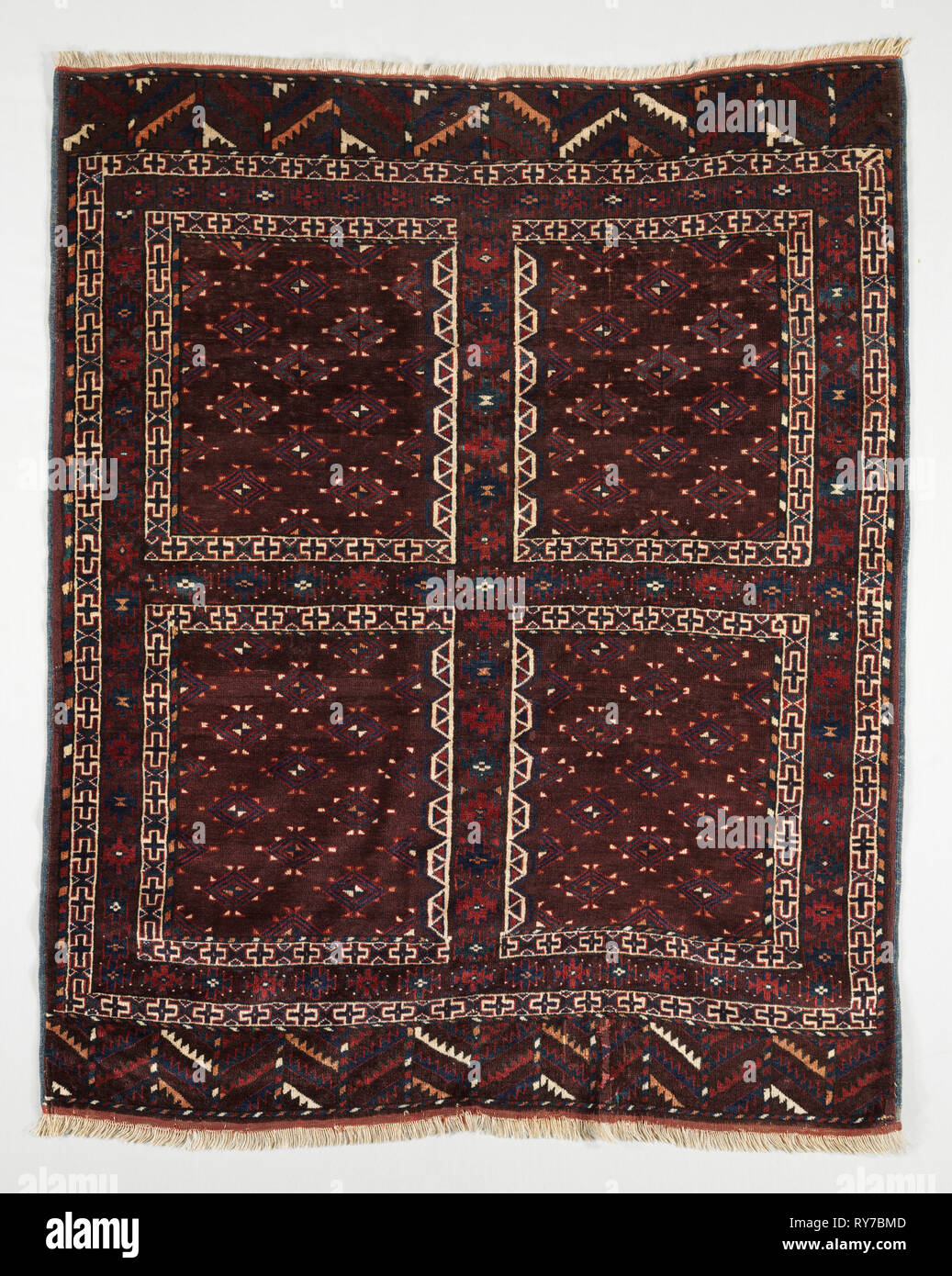 Door Rug (Ensi), c. 1900. Turkmenistan, Yomud, 19th century. Knotted pile, asymmetrical knot, 117 knots psi; wool; overall: 183 x 142 cm (72 1/16 x 55 7/8 in Stock Photo