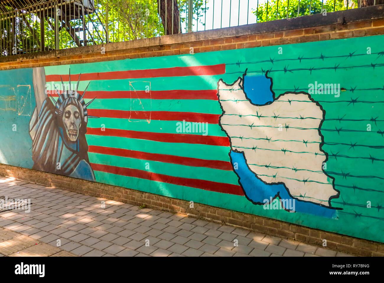 Tehran US Den of Espionage Former United States of America Embassy Anti American Iranian Patriotic Propaganda Statue of Liberty Stripes Barbed Wire - Stock Image