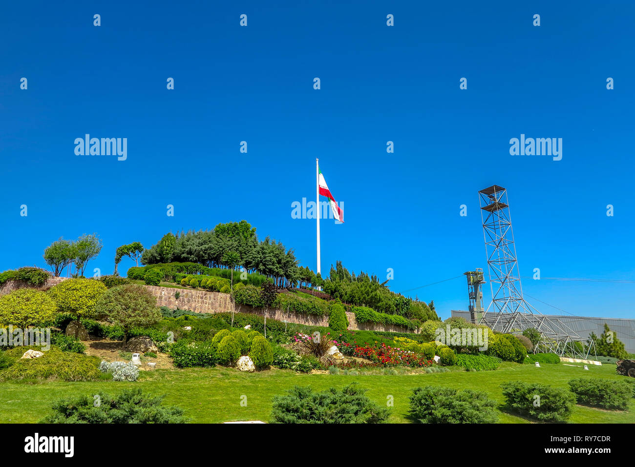 Tehran Ab-o Atash Park with View of Iran Flag Tower - Stock Image