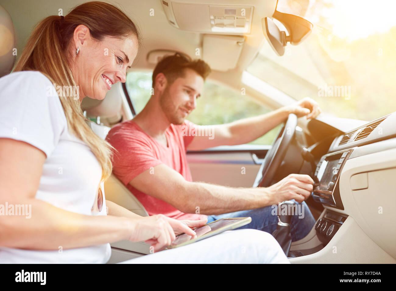 Couple uses GPS as Navi while driving on tablet computer - Stock Image
