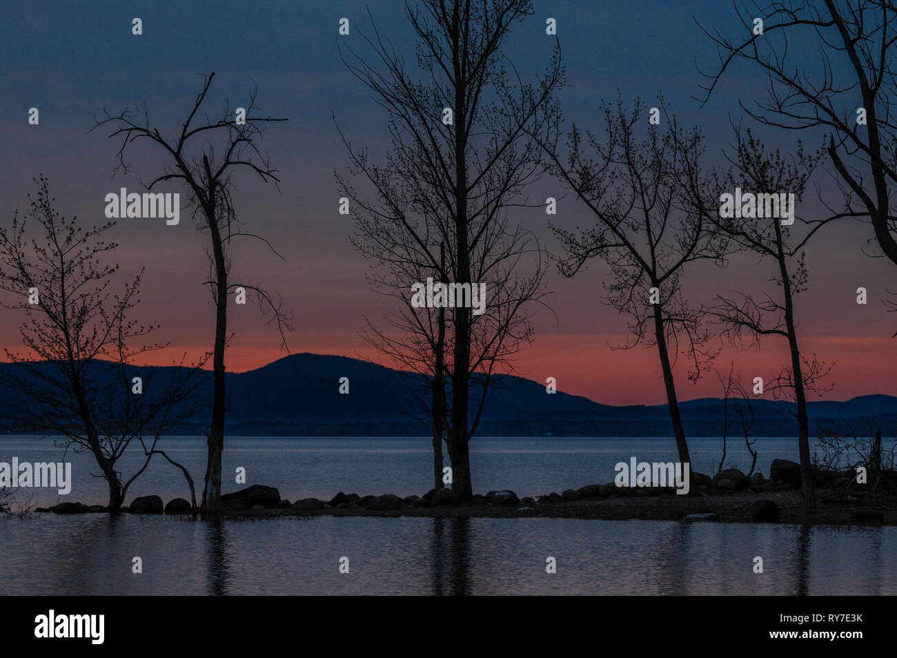 Last light in spring at the Great Sacandaga Lake in New York State - Stock Image