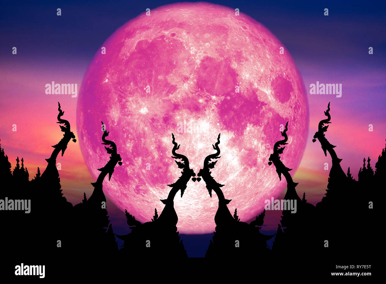 super pink moon back over silhouette art on roof of Buddhist temple and sunset sky, Elements of this image furnished by NASA - Stock Image