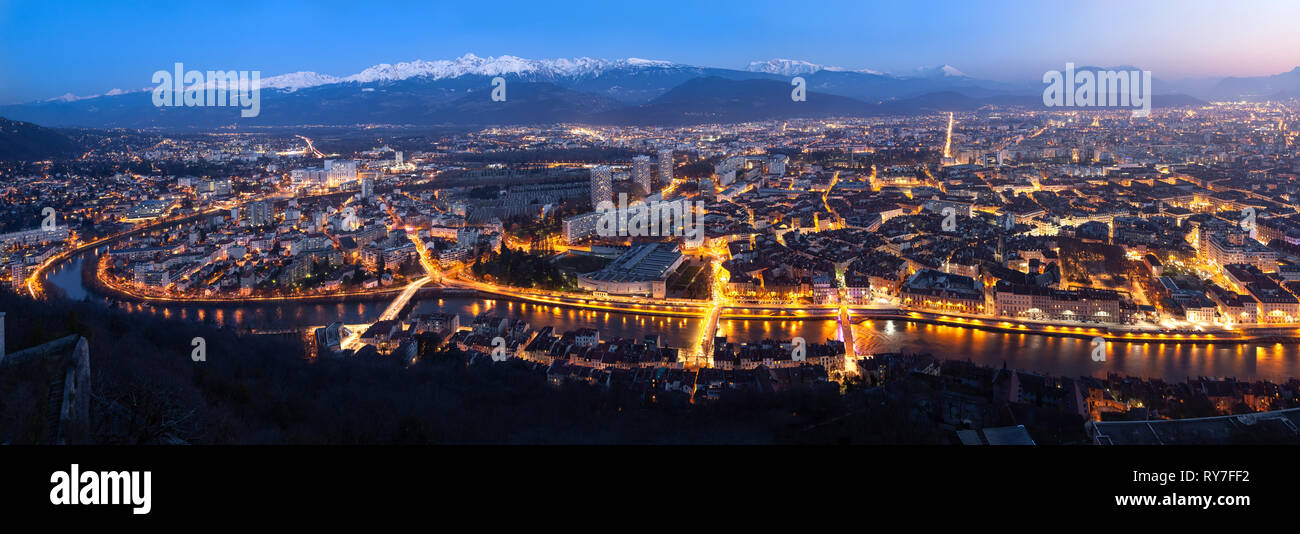 Aerial panorama of Grenoble at dusk, France - Stock Image