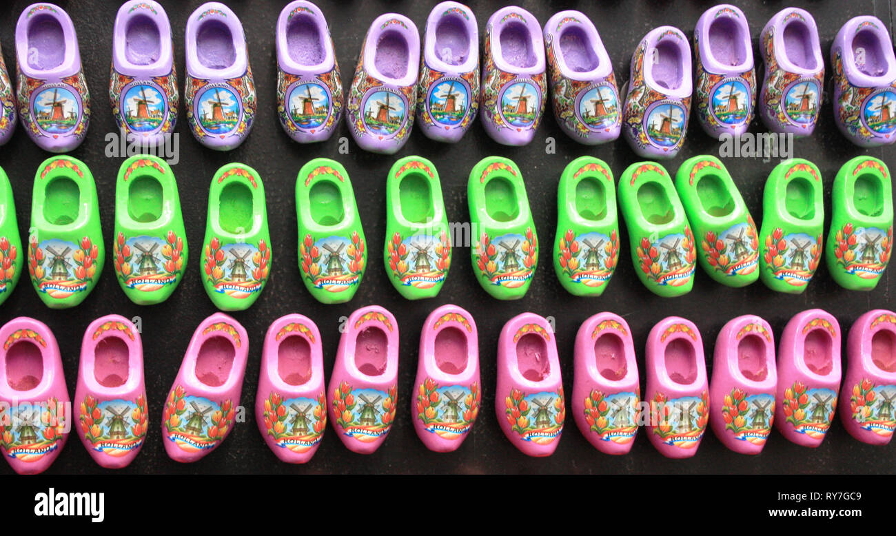 typical Dutch shoes. traditional red Amsterdam clogs bought as souvenir gifts - Stock Image