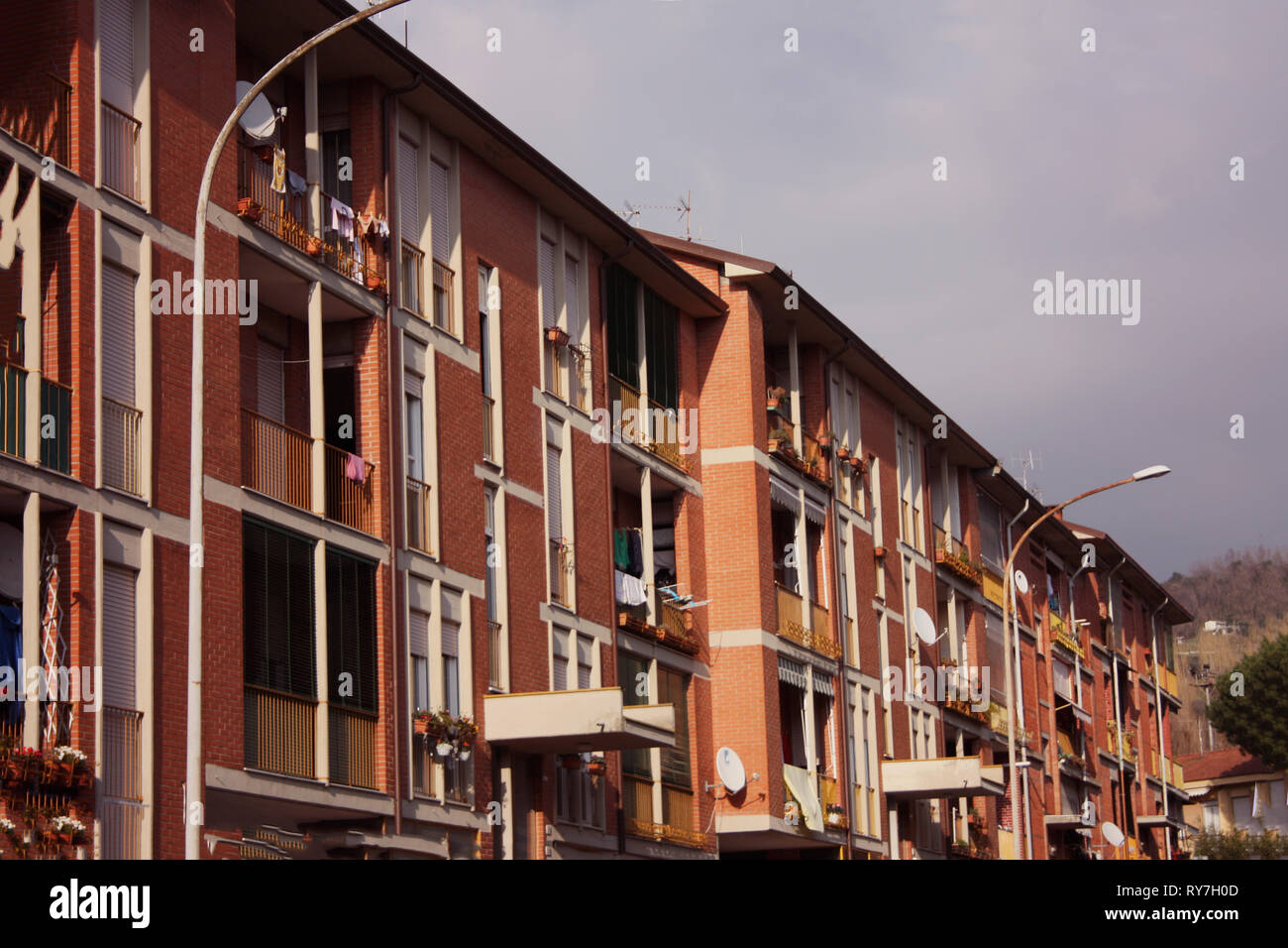 barracks and buildings of public houses built with a cold red brick - Stock Image
