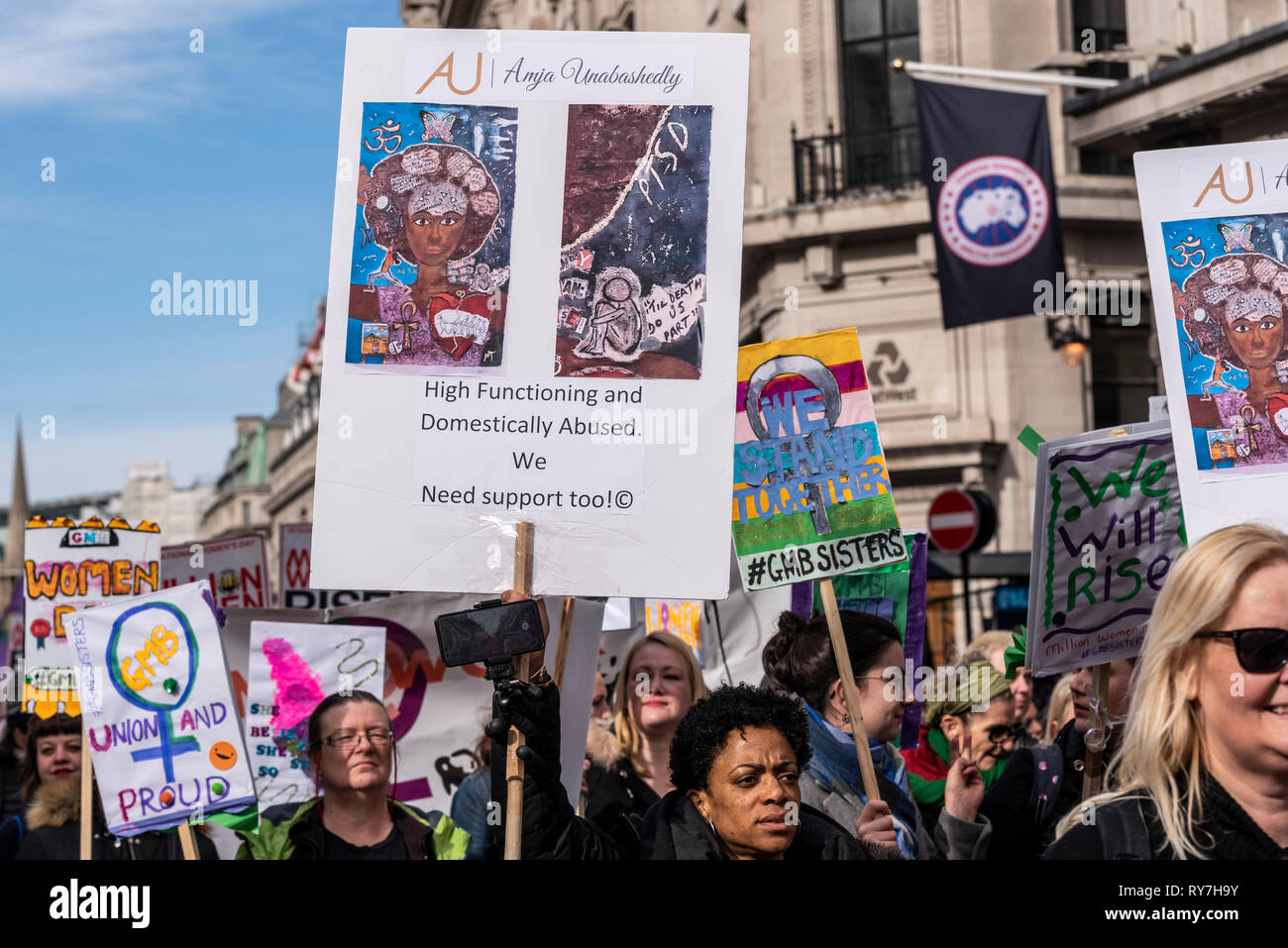 Million Women Rise protest march. Thousands of women and children marched through London to raise awareness of violence towards women - Stock Image