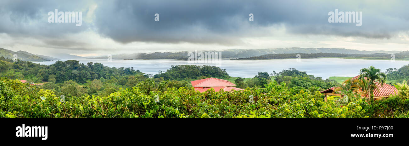 Panoramic view of Lake Arenal in central Costa Rica under dramatic cloudy sky - Stock Image