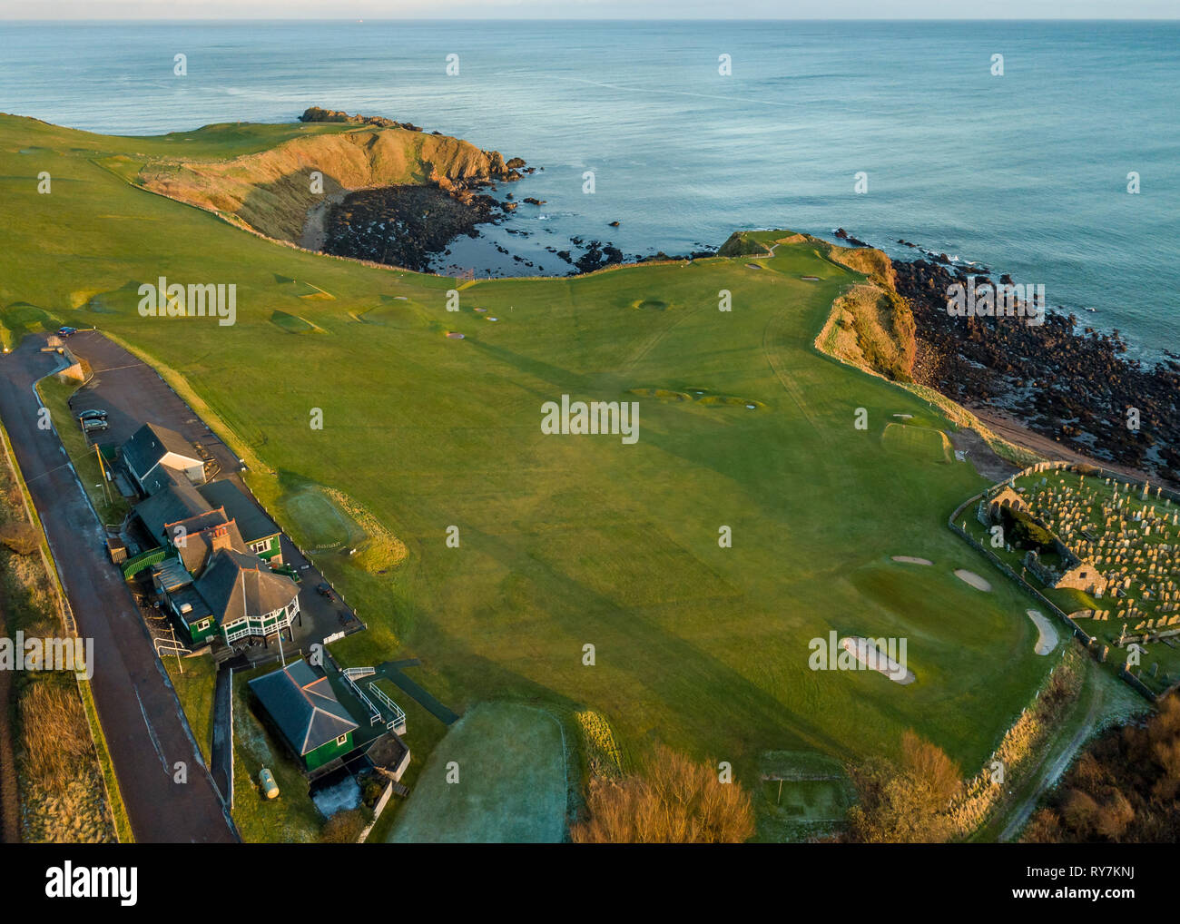 An aerial view of Stonehaven golf course as the sun begins to set, Aberdeenshire, Scotland - Stock Image