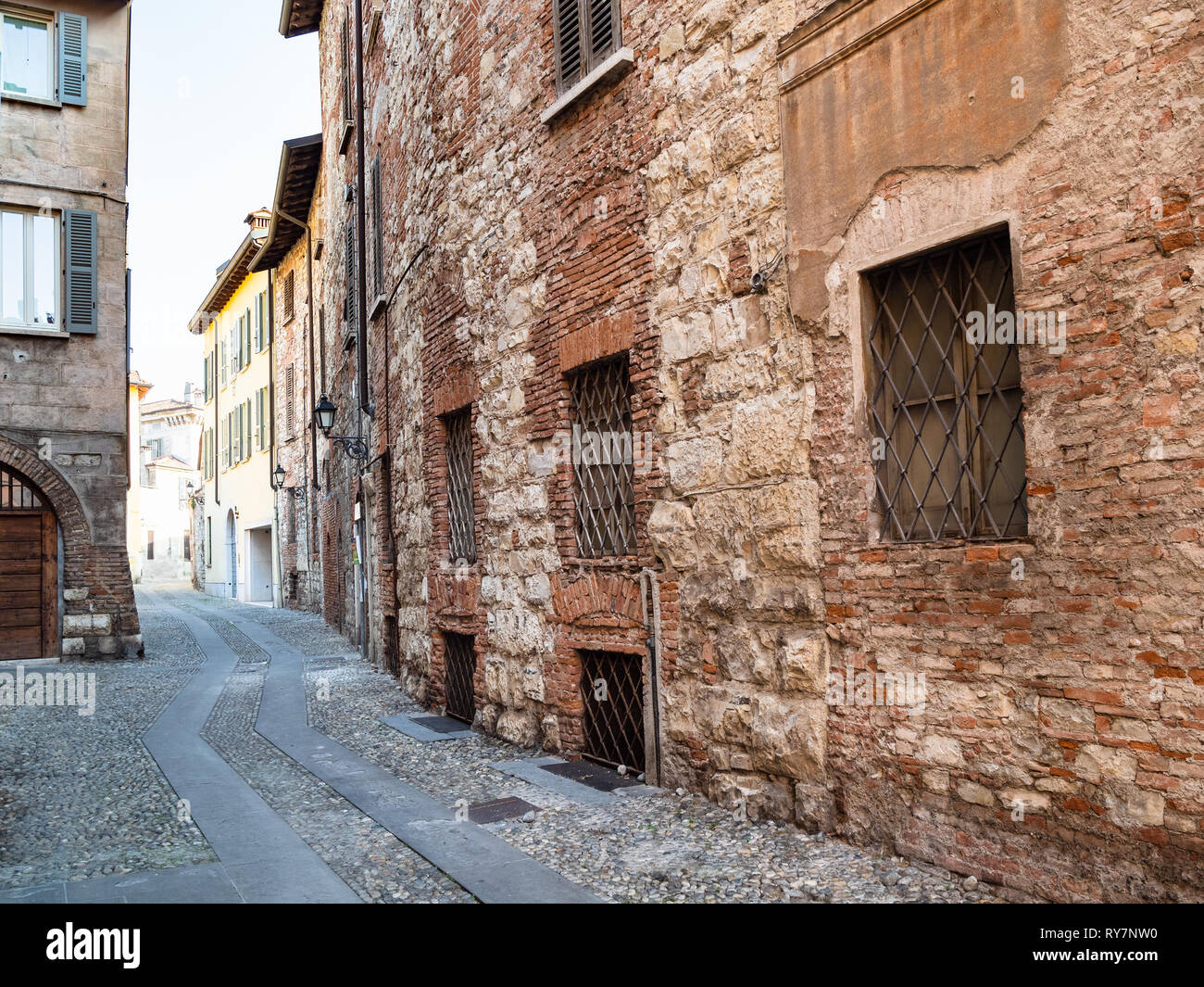 Travel to Italy - narrow medieval street Vicolo San Clemente with old brick house in Brescia city, Lombardy Stock Photo