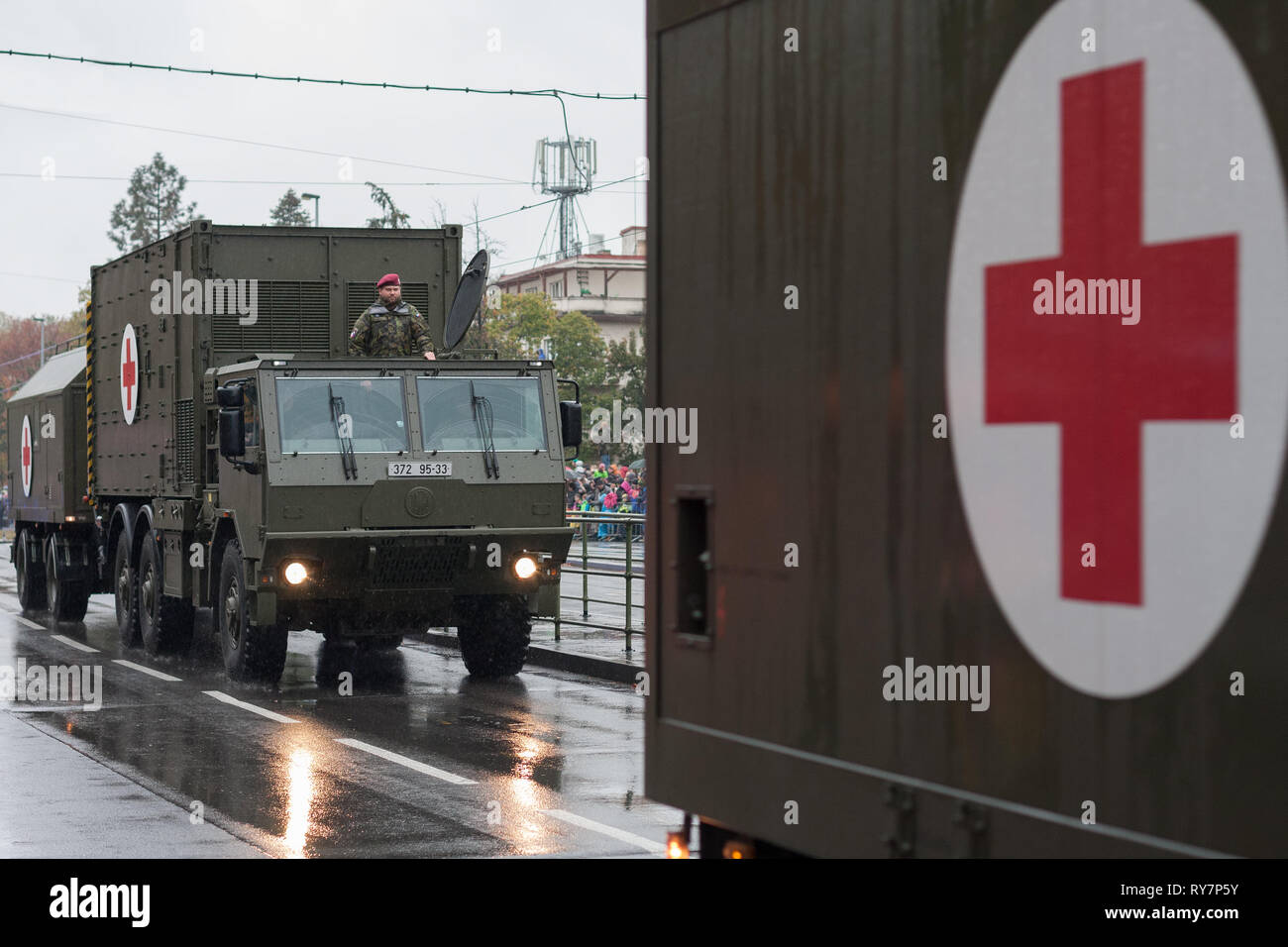 European street, Prague-October 28, 2018: Soldiers of Czech Army are riding mobile casualty ward on military parade on October 28, 2018 in Prague - Stock Image