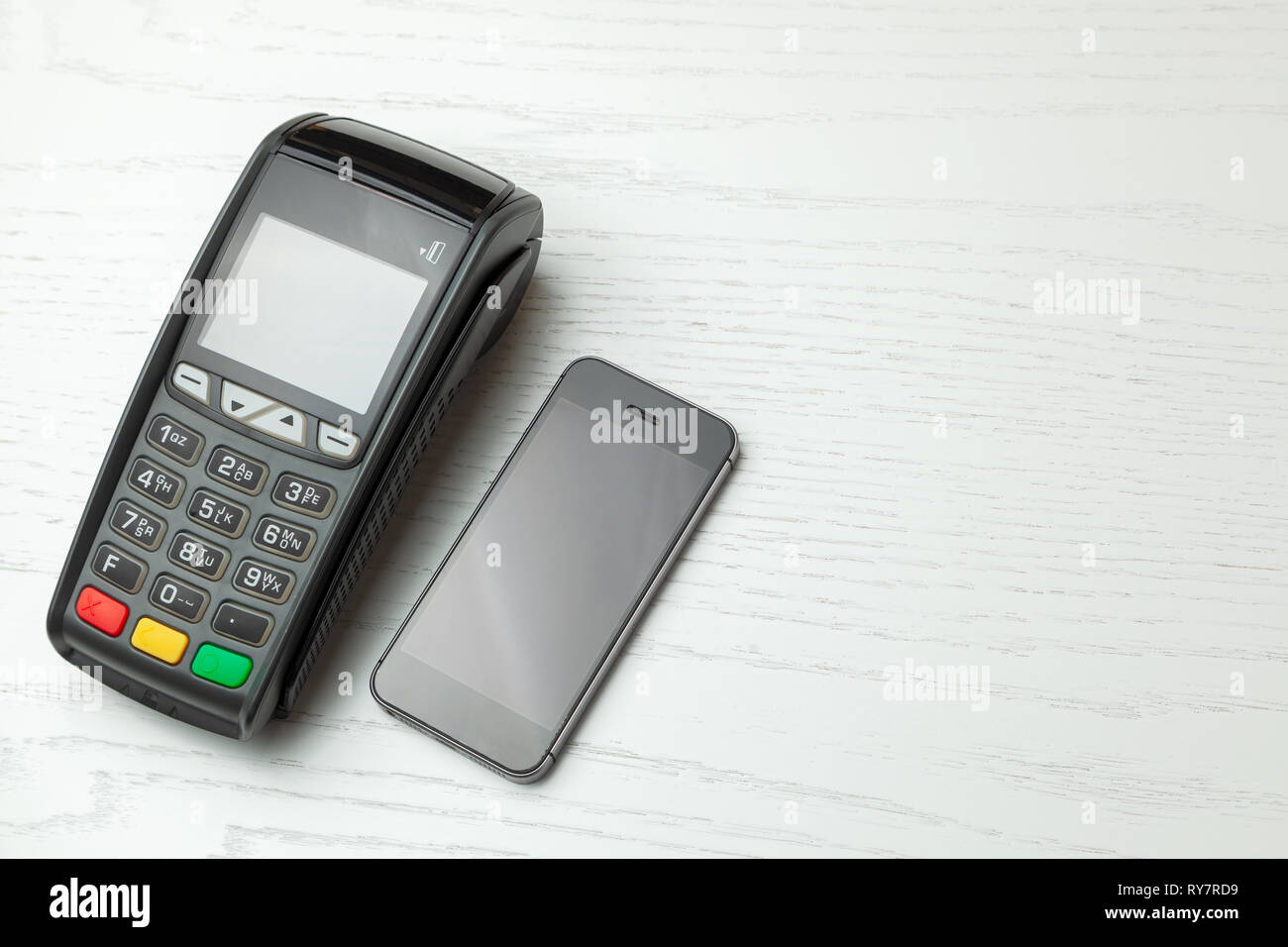POS terminal, Payment Machine with mobile phone on white background. Contactless payment with NFC technology. - Stock Image
