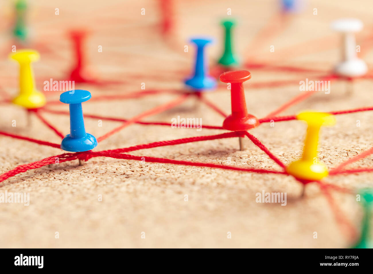 Business team. Connect between people. Office pins connected by red thread Stock Photo