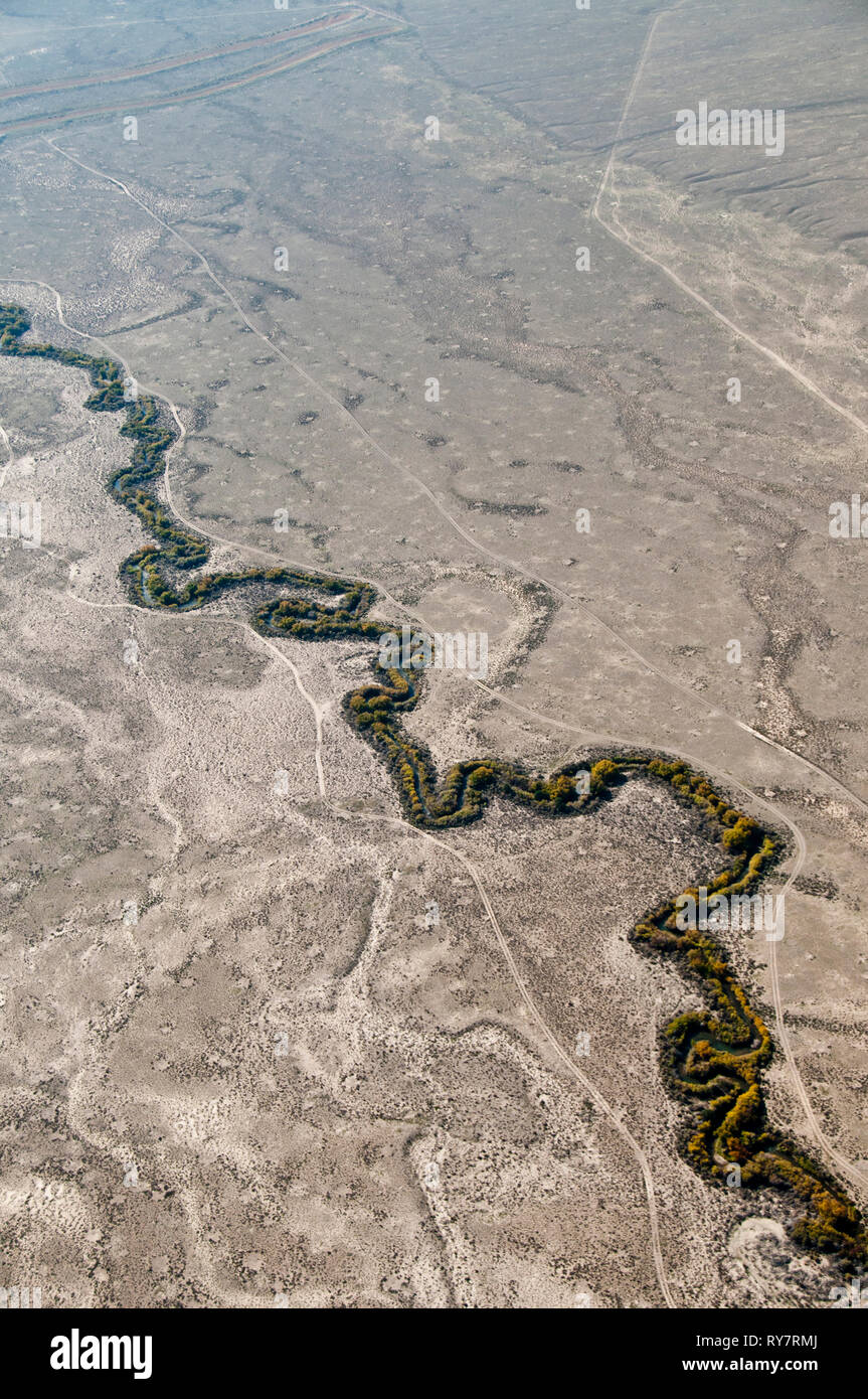 Meandering desert stream in arid desert habitat in south-central Idaho - Stock Image