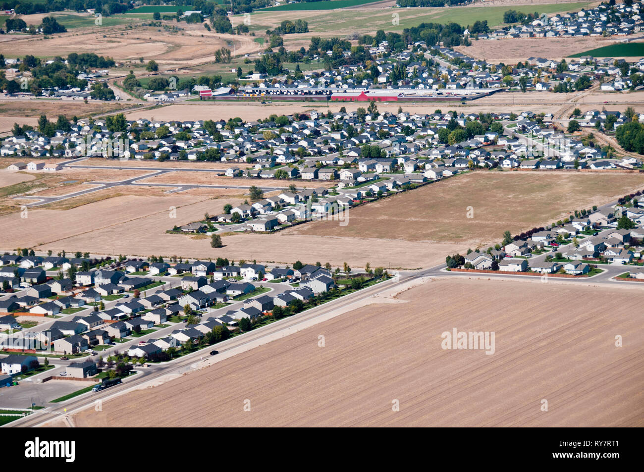 Subdivisions encroaching on farmland near Boise, Idaho - Stock Image