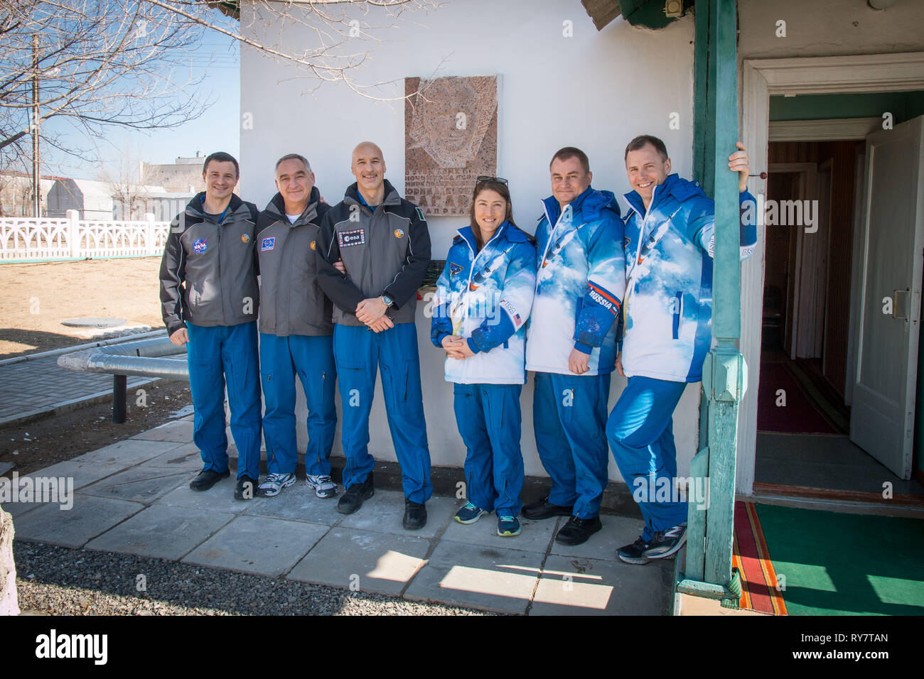 International Space Station Expedition 59 prime and backup crew members pose for a group photo outside the cottage that Yuri Gagarin slept in the night before his historic mission at the Baikonur Cosmodrome March 10, 2019 in Baikonur, Kazakhstan. From left to right are the backup crew members, Drew Morgan of NASA, Alexander Skvortsov of Roscosmos and Luca Parmitano of the European Space Agency, and the prime crew members, Christina Koch of NASA, Alexey Ovchinin of Roscosmos and Nick Hague of NASA. Expedition 59 crew will launch March 14th onboard the Soyuz MS-12 spacecraft for a six-and-a-half - Stock Image