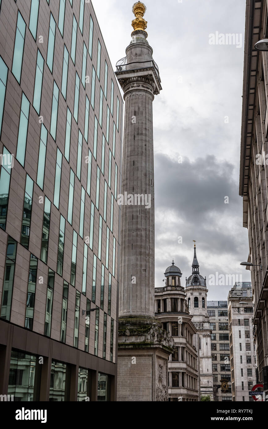 The chequerboard facade of the Monument Building at Monument, City of London. - Stock Image
