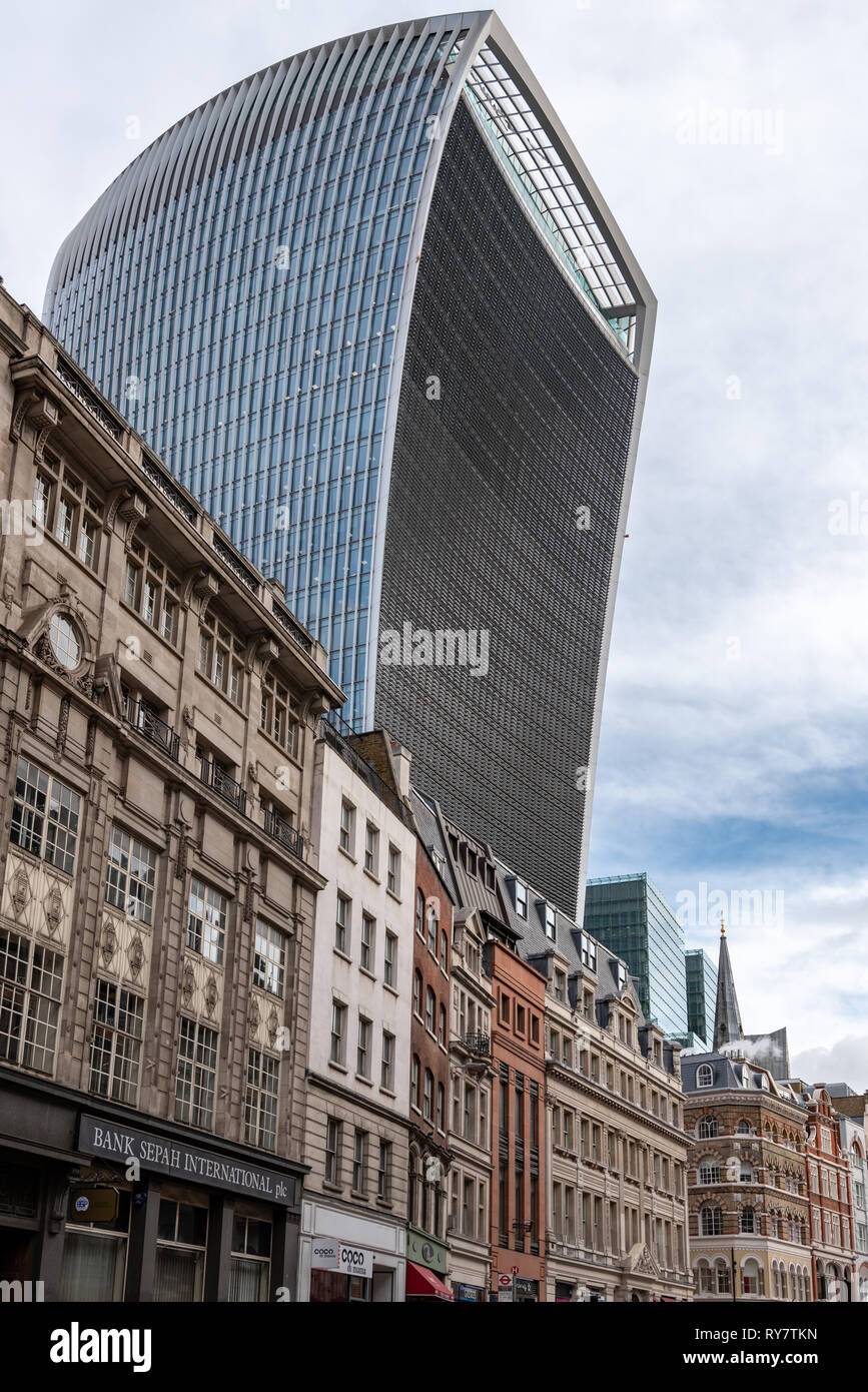 The mass of the Walkie-talkie looms ominously over the more traditional Eastcheap buildings - Stock Image