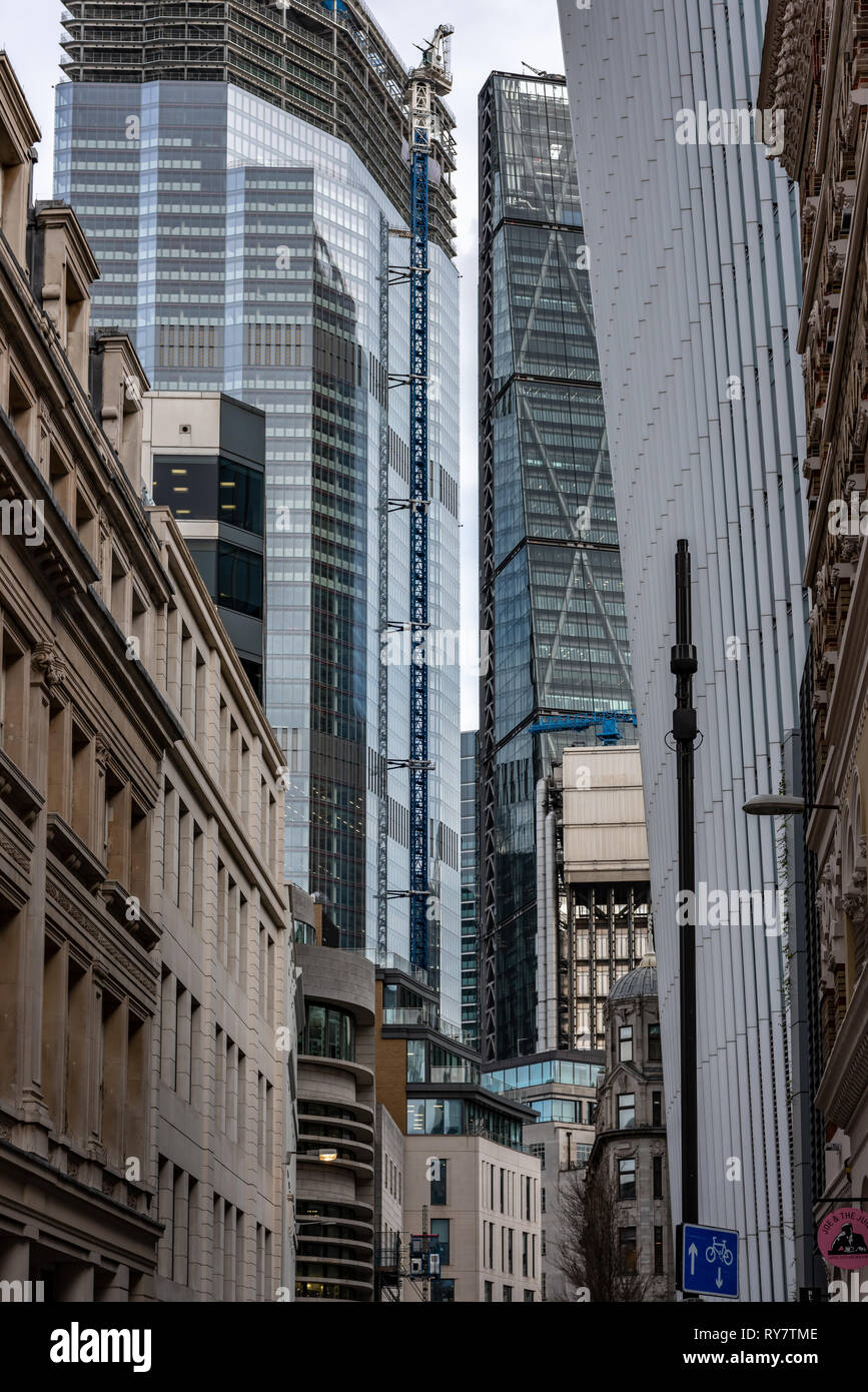 High finance crowds out the more traditional buildings of Philpot Lane in the City of London - Stock Image
