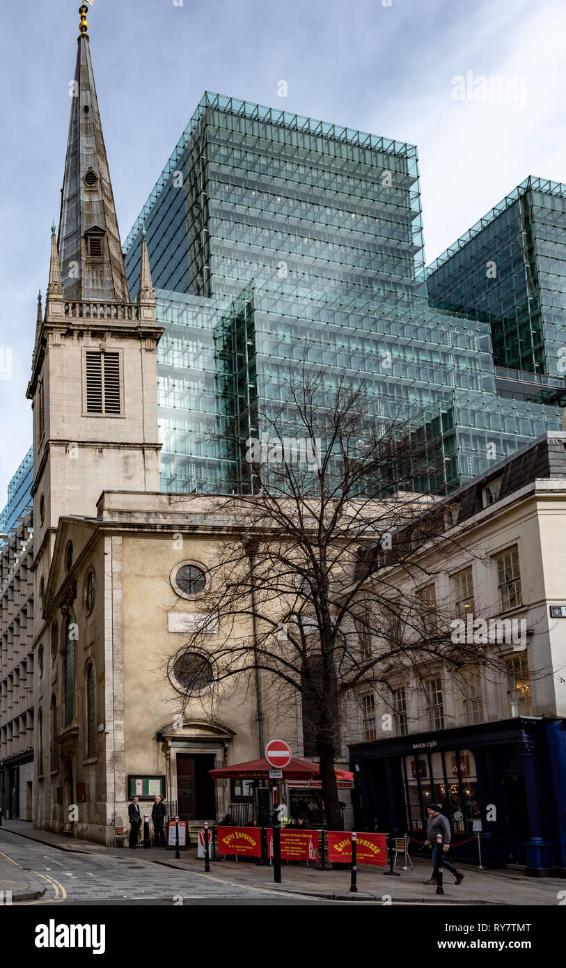 God versus Mammon in Rood Lane, as Plantation Place towers over the spire of St Margaret Patten's church - Stock Image