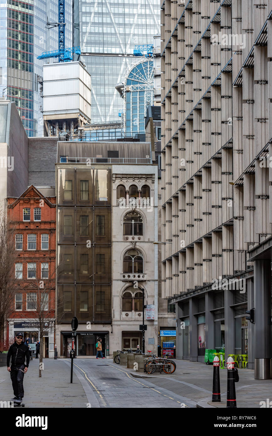 Colourful traditional buildings in Fenchurch Street contrast starkly with the glass and steel towers behind - Stock Image