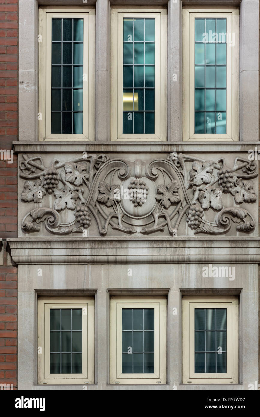 Ornate reliefs decorating an office in East Cheap, City of London Stock Photo