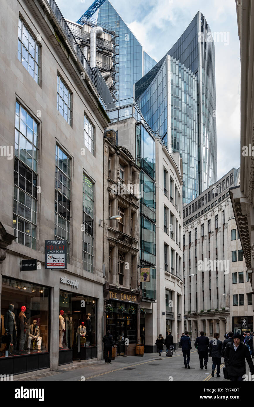 The Lloyds of London building, 'Scalpel', and Wllis Building loom over far end of Lime Street in the City of London - Stock Image