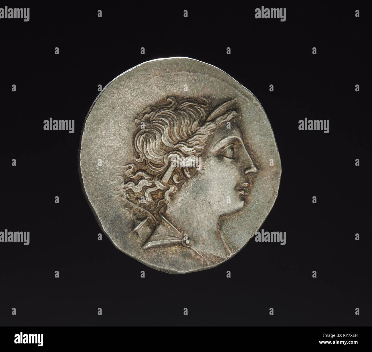 Tetradrachm Coin of Erognetos, Magistrate of Magnesia, 155-145 BC. Turkey, Ionia, Magnesia on the Maeander, Hellenistic Period. Silver; diameter: 3.2 x 0.5 cm (1 1/4 x 3/16 in - Stock Image