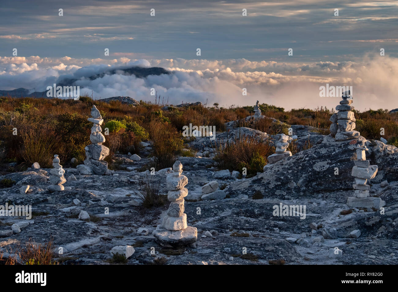 Rock Piles on Table Mountain backed by Constantiaberg Mountain, Cape Town, Western Cape, South Africa - Stock Image