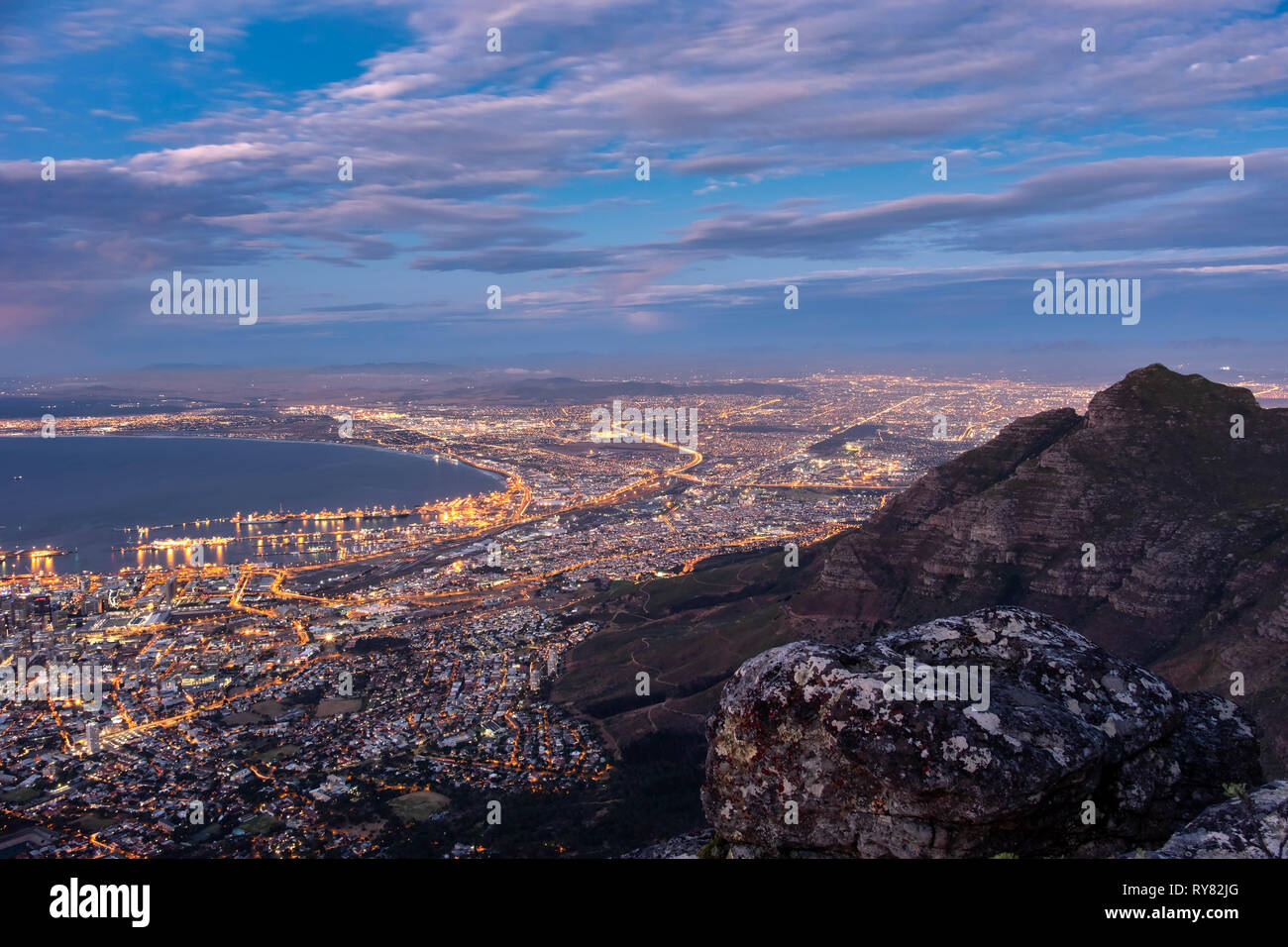 The Devils Peak and City of Cape Town from Table Mountain at sunset, Cape Town, Western Cape, South Africa - Stock Image