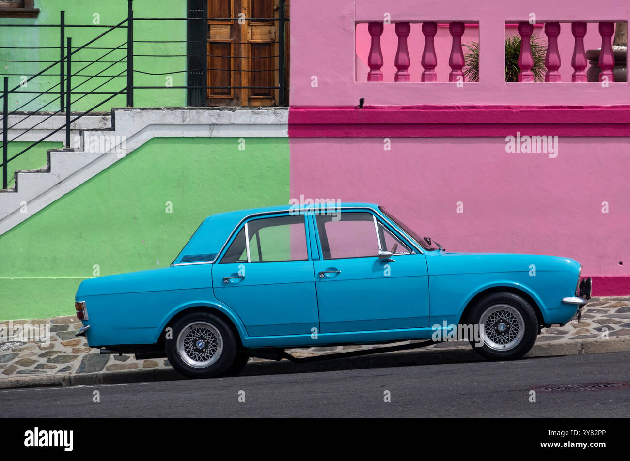 Old Blue Ford Cortina Car in front of Multi Coloured Houses of Bo Kaap, Cape Town, Western Cape, South Africa Stock Photo