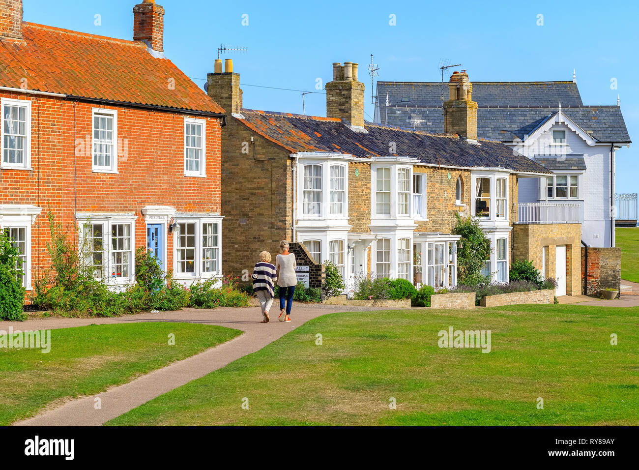 Southwold, UK - September 6, 18 - Back view of two female tourists walking in the popular seaside town Southwold of the UK - Stock Image