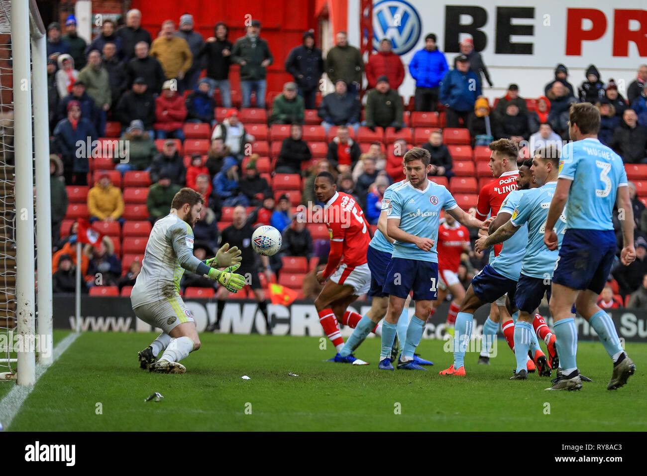 9th March 2019, Oakwell, Barnsley, England; Sky Bet League One, Barnsley vs Accrington Stanley ; Jonathan Maxted (01) of Accrington Stanley saves from a header by Liam Lindsay (06) of Barnsley    Credit: John Hobson/News Images  English Football League images are subject to DataCo Licence - Stock Image