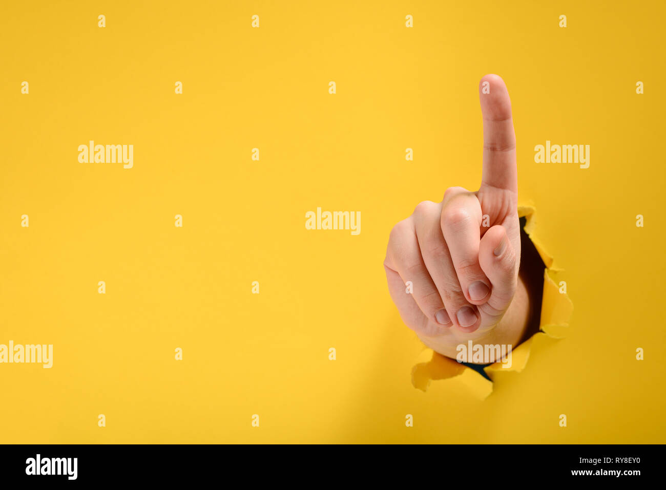 Hand pointing up - Stock Image