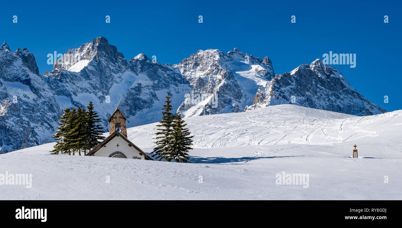 Col du Lautaret, Hautes-Alpes La Meije, Alps, France: Panoramic winter view on the Ecrins National Park glaciers with La Chappelle des Fusillés Stock Photo