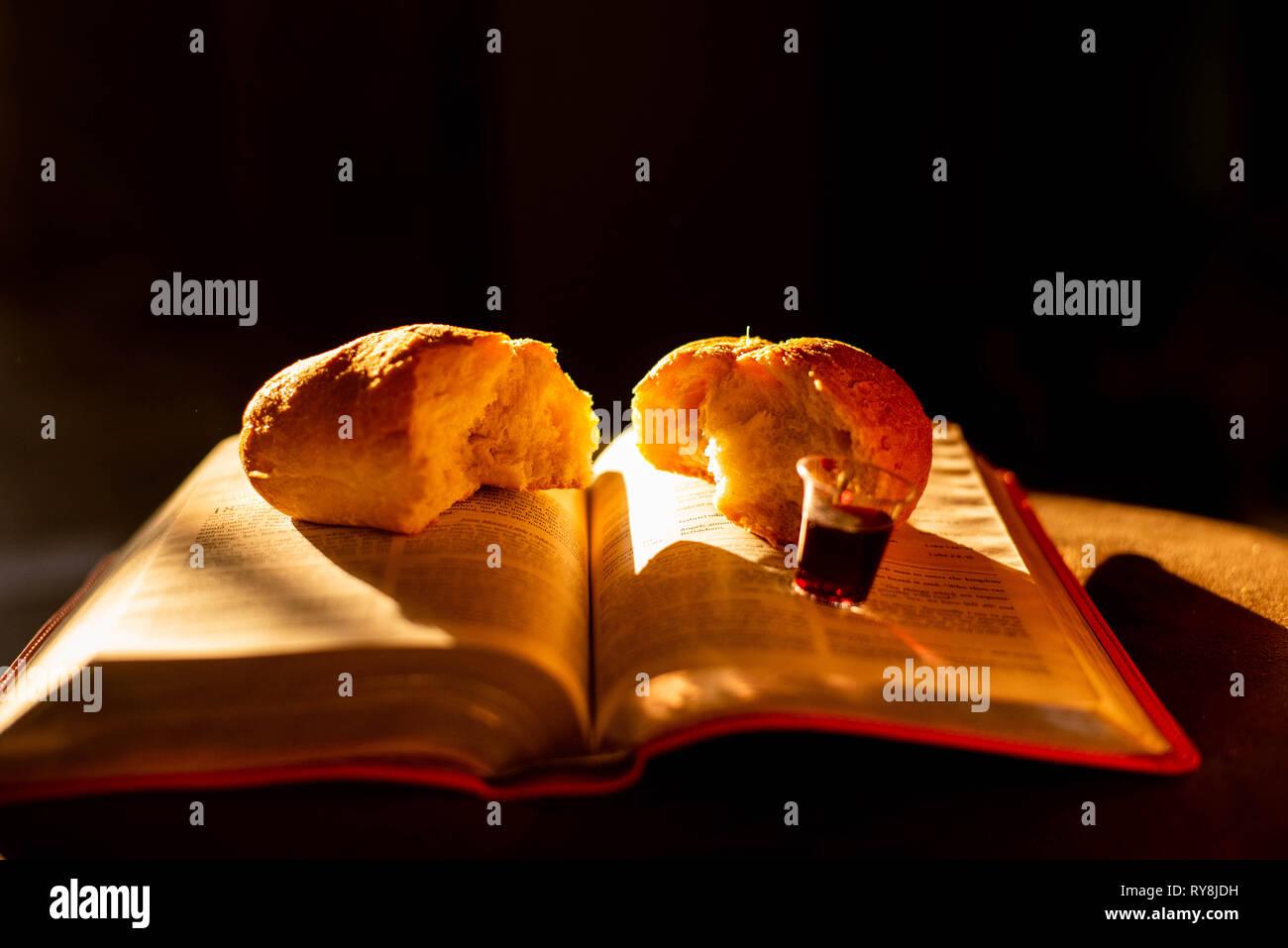 Communion cups and bread represent the last supper of Jesus