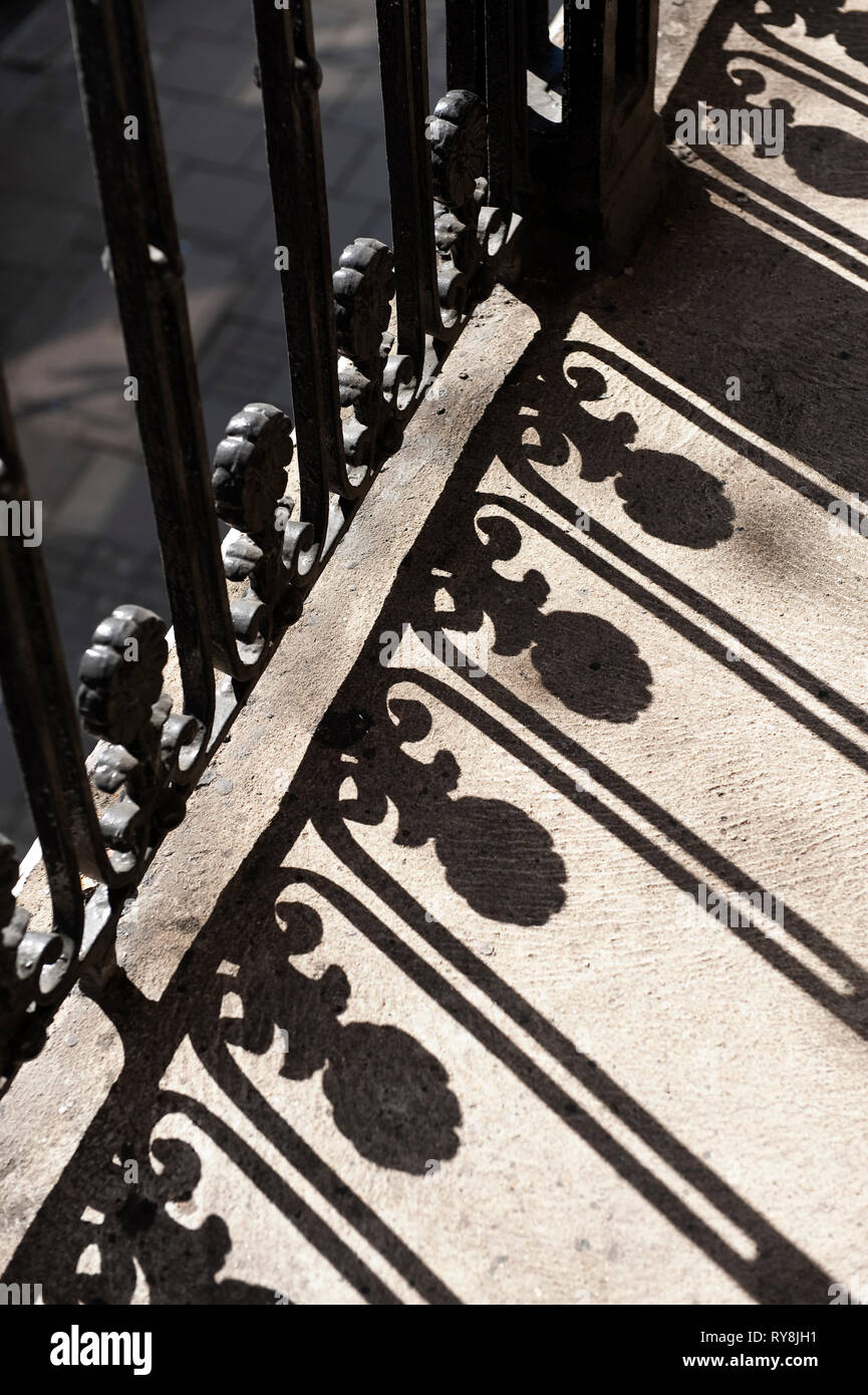 'Railings casting shadows at TEFL Lab in London, England' - Stock Image