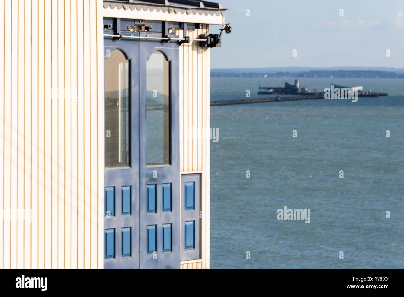 Southend Cliff Lift and Southend Pier. Cliff top restored station building overlooking the Thames Estuary, Southend on Sea, Essex, UK. Space for copy - Stock Image