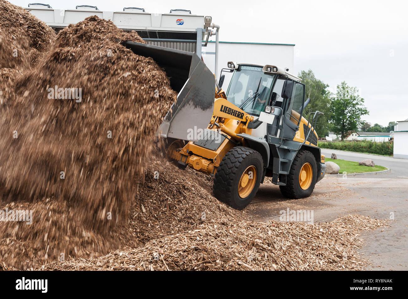 Bulldozer moving saw dust - Stock Image