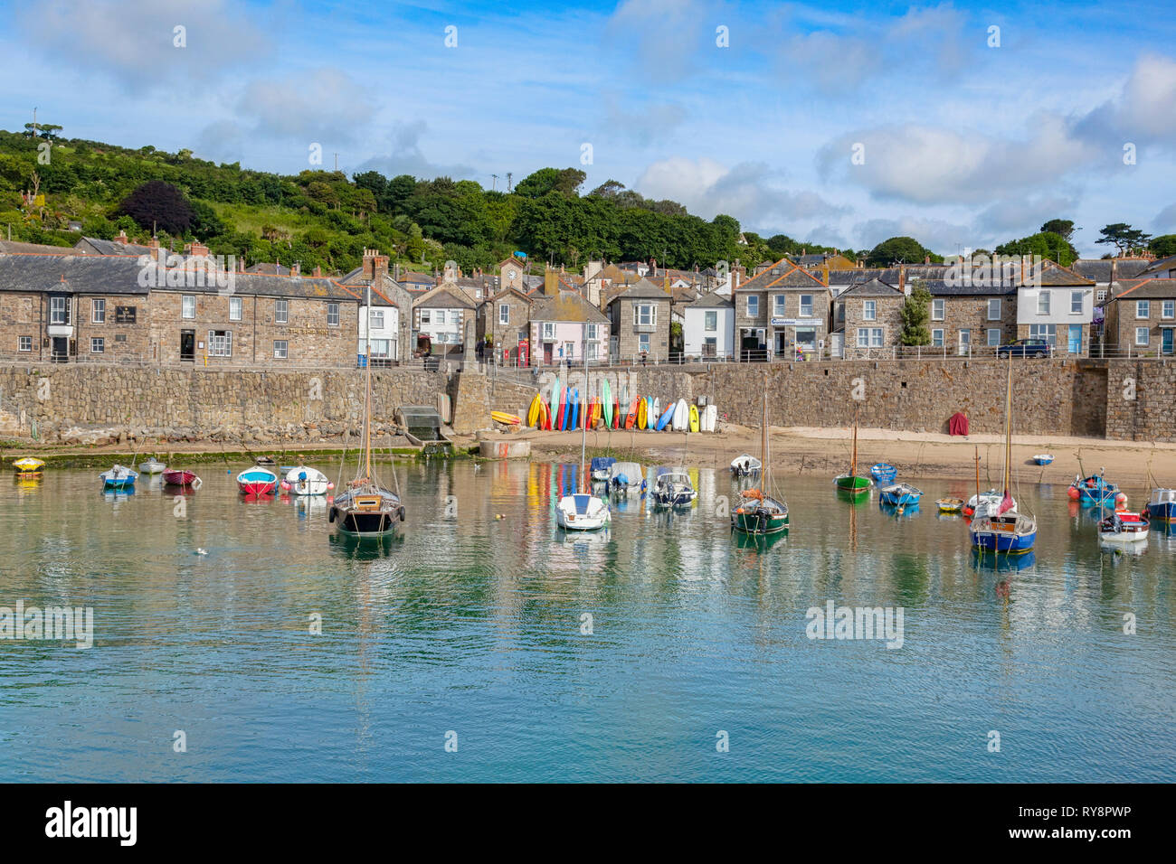 15 June 2018: Mousehole, Cornwall, UK - The harbour and village. Stock Photo