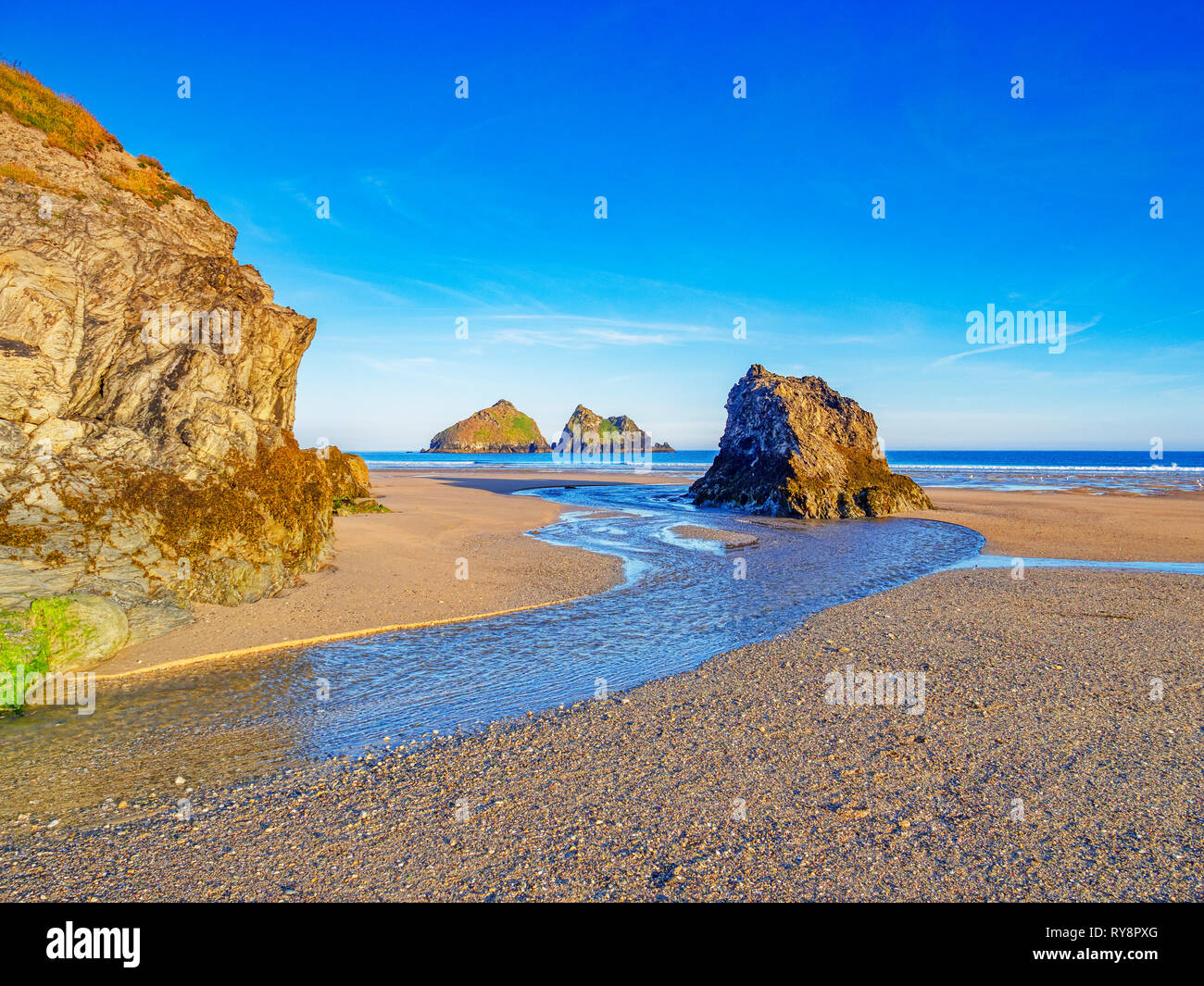 Rocks on Holywell Beach, with a view through  to Carters Rocks, North Cornwall, UK Stock Photo
