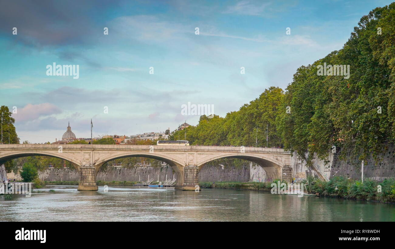 The water on the Tiber river in Rome Italy with the bridge on it across the castle fortress of Sant Angelo - Stock Image