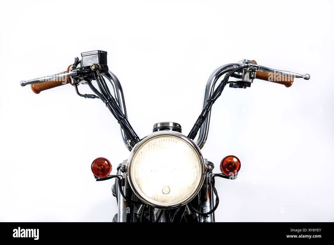 Close up of headlight on vintage motorcycle. Custom chopper / scrambler motocross. Retro motorbike on white background. Blank copy space for text. - Stock Image