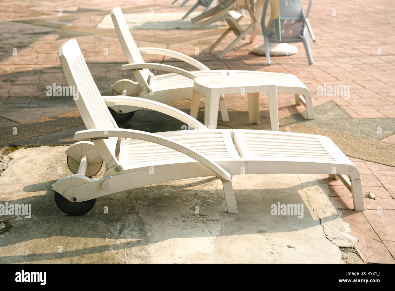 Deck chairs by the pool in a swimming club - Stock Image