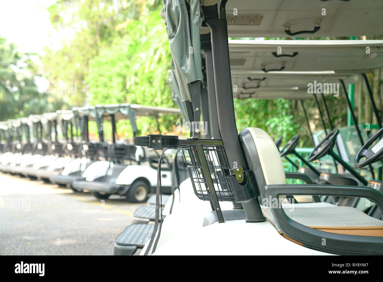 Recreation or transport concept : Golf carts parked outside a golf club - Stock Image