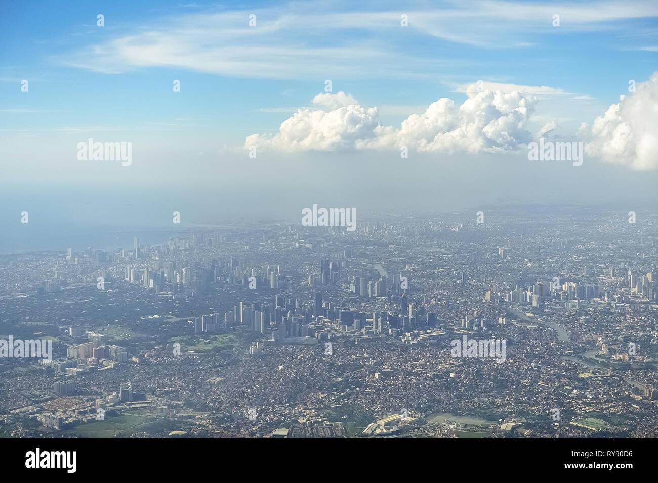 Aerial Shot of Metro Manila Metropolis on sunny day -  Philippines - Stock Image